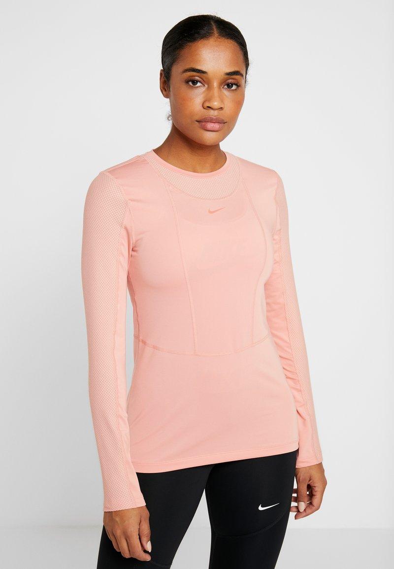 Nike Performance - WARM HOLLYWOOD - Koszulka sportowa - pink quartz/clear