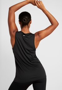 Nike Performance - YOGA TANK KEYHOLE - Koszulka sportowa - black/vast grey