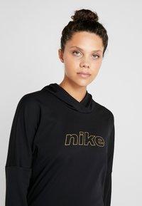 Nike Performance - MIDLAYER GLAM  - Hoodie - black/metallic gold - 3