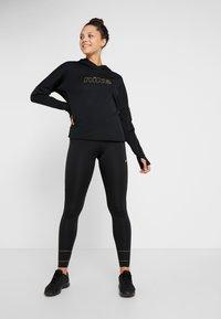 Nike Performance - MIDLAYER GLAM  - Hoodie - black/metallic gold - 1