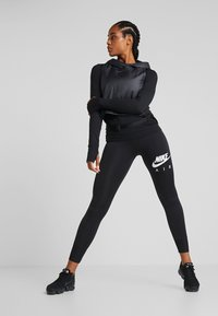 Nike Performance - INFINITE TOP  - Sports shirt - black/reflective silver - 1
