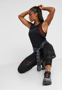 Nike Performance - DRY MILER TANK - Funkční triko - black/metallic silver - 1