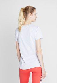 Nike Performance - DRY TEE CREW - Print T-shirt - white/black - 2