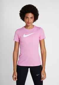 Nike Performance - DRY TEE CREW - Triko spotiskem - magic flamingo - 0