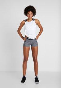 Nike Performance - DRY ELASTIKA TANK - Sports shirt - white/black - 1