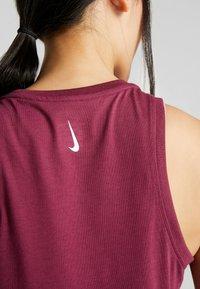 Nike Performance - DRY TANK YOGA - Sports shirt - villain red - 5