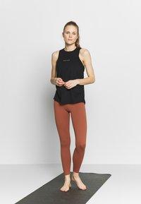 Nike Performance - DRY TANK YOGA - Sports shirt - black/dark smoke grey - 1