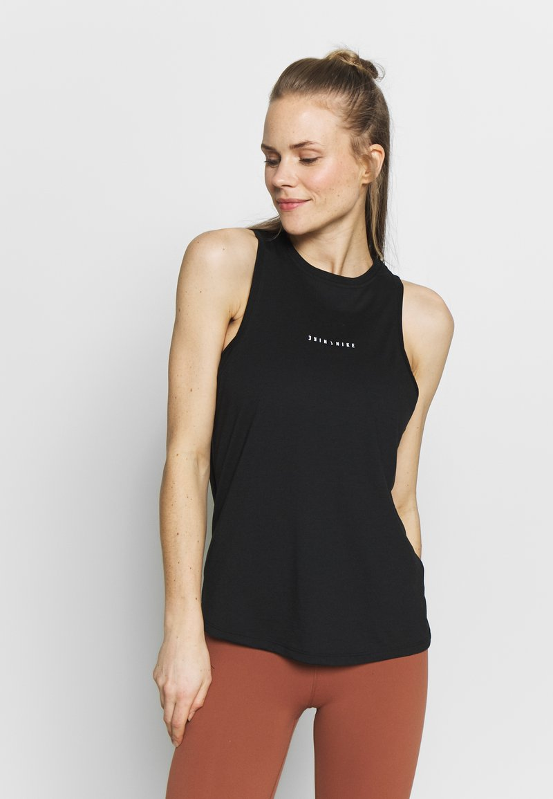 Nike Performance - DRY TANK YOGA - Sports shirt - black/dark smoke grey