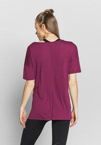Nike Performance - YOGA LAYER - Basic T-shirt - villain red/shadowberry - 2