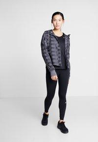 Nike Performance - Sports shirt - black - 1