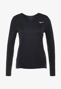 Nike Performance - Sports shirt - black - 4