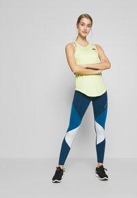 Nike Performance - Sports shirt - limelight - 1