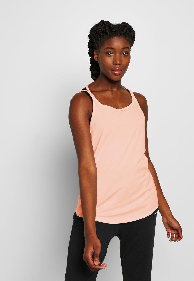 Nike Performance - YOGA STRAPPY TANK - Sportshirt - washed coral