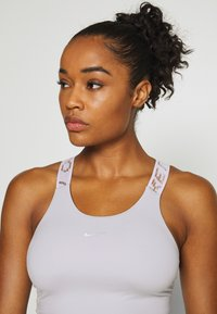 Nike Performance - CROP TANK - Sports shirt - photon dust/infinite lilac/metallic silver - 4