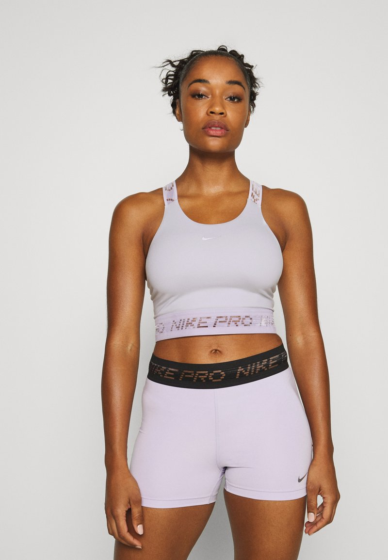 Nike Performance - CROP TANK - Sports shirt - photon dust/infinite lilac/metallic silver