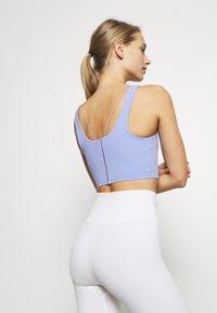Nike Performance - YOGA LUXE CROP TANK - Sports bra - light thistle/sapphire - 2