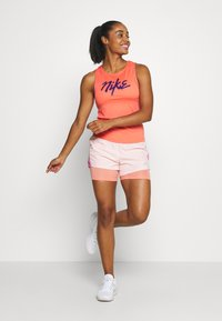 Nike Performance - TANK RUNWAY - Sports shirt - magic ember/eggplant - 1