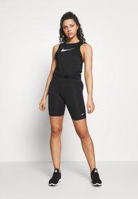 Nike Performance - TANK ESSENTIAL - Tekninen urheilupaita - black - 1