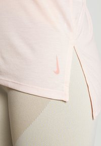 Nike Performance - YOGA LAYER TANK - Sports shirt - washed coral/pink quartz - 4