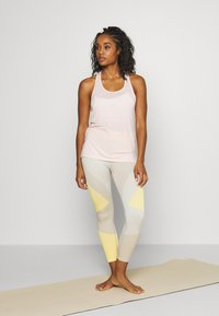Nike Performance - YOGA LAYER TANK - Sports shirt - washed coral/pink quartz - 1
