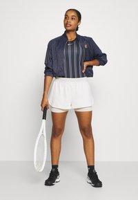 Nike Performance - DRY TANK PRINTED - Sports shirt - black/white - 1