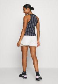 Nike Performance - DRY TANK PRINTED - Sports shirt - black/white - 2