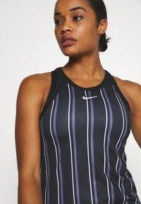Nike Performance - DRY TANK PRINTED - Sports shirt - black/white - 3