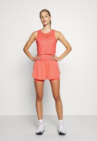 Nike Performance - DRY TANK - Sports shirt - sunblush/white - 1