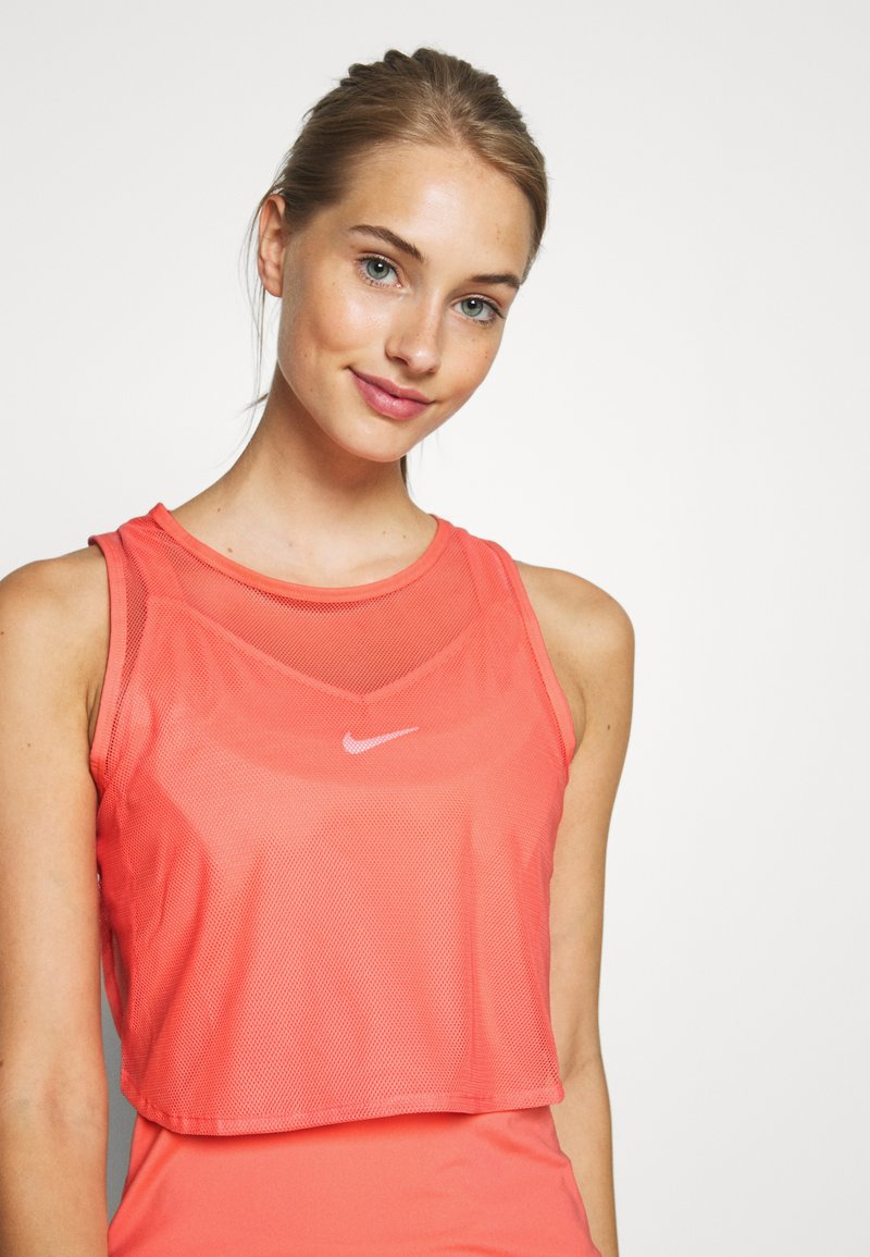 Nike Performance - DRY TANK - Sports shirt - sunblush/white