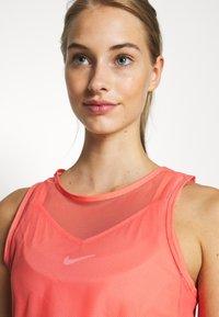 Nike Performance - DRY TANK - Camiseta de deporte - sunblush/white - 4