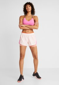 Nike Performance - 10K 2IN1 SHORT - Träningsshorts - echo pink/china rose/cosmic clay/wolf grey - 1
