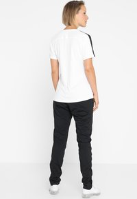Nike Performance - DRY PANT  - Jogginghose - black/black/white - 2