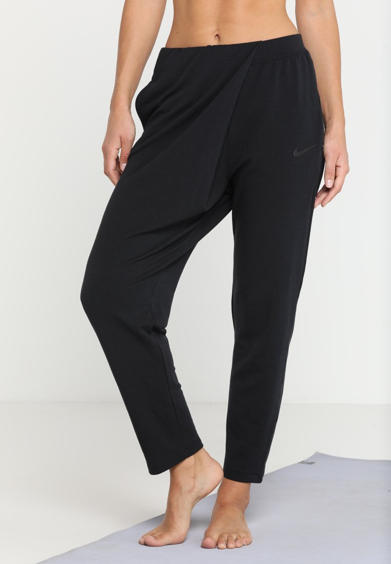 Nike Performance - YOGA LOOSE PANT - Pantalon de survêtement - black/black