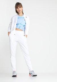Nike Performance - Pantalon de survêtement - white - 1