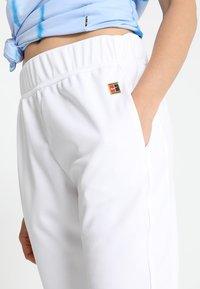 Nike Performance - Pantalon de survêtement - white - 4
