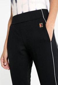 Nike Performance - Tracksuit bottoms - black/white/white - 3