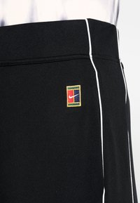 Nike Performance - Tracksuit bottoms - black/white/white - 6