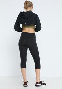 Nike Performance - NIKE ONE TIGHT CAPRI - Tights - black/white - 2
