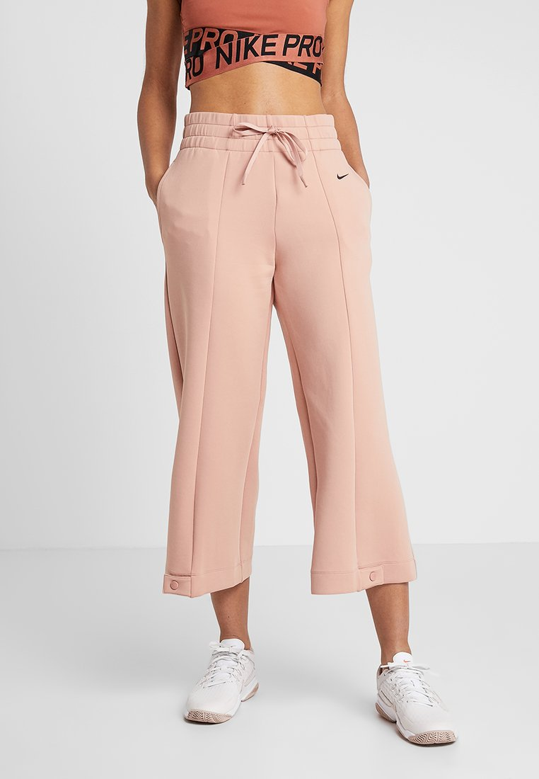 Nike Performance - DRY PANT GYM - Tracksuit bottoms - rose gold