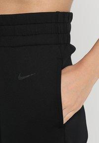 Nike Performance - DRY PANT GYM - Träningsbyxor - black/black - 7