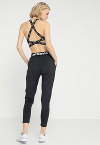 Nike Performance - PANT - Tracksuit bottoms - black/white - 2