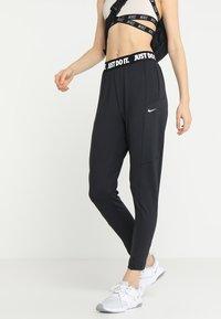 Nike Performance - PANT - Tracksuit bottoms - black/white - 0