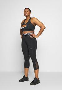 Nike Performance - CROP PLUS - Tights - black/white - 1