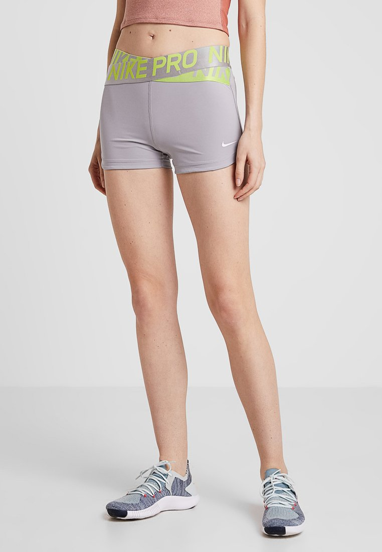 Nike Performance - INTERTWIST SHORT - Tights - atmosphere grey/cyber