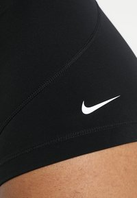 Nike Performance - W NP SHRT 3IN - Leggings - black/white - 6
