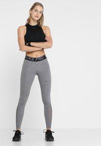 Nike Performance - W NP TIGHT - Legging - gunsmoke/heather/gunsmoke/black - 1