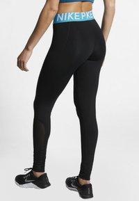 Nike Performance - W NP TIGHT - Leggings - black/turquoise/white - 2