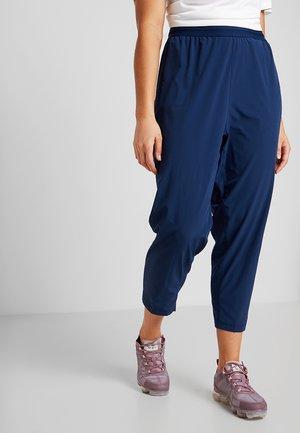 Teplákové kalhoty - blue void/reflective silver