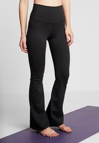 Nike Performance - STUDIO FLARE - Pantalon de survêtement - black - 0