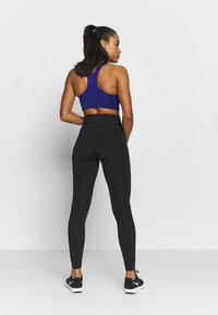 Nike Performance - W NIKE ONE LUXE TIGHT - Tights - black - 2